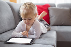 Young girl using tablet computer Royalty Free Stock Photo