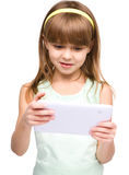 Young girl is using tablet royalty free stock photos
