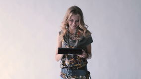 Young girl using a tablet PC and smiling.  stock footage