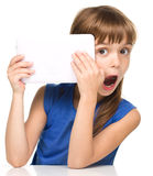 Young girl is using tablet royalty free stock images