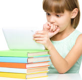 Young girl is using tablet while studying Royalty Free Stock Photo