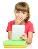 Young girl is using tablet while studying Stock Photography