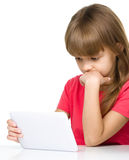 Young girl is using tablet while studying Stock Images