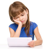 Young girl is using tablet Royalty Free Stock Image