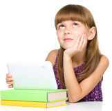 Young girl is using tablet Stock Photography