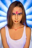 Young girl with UV make-up artistic portrait Stock Photography