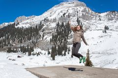 A young girl on vacation in the mountains. Happy beautiful girl in the mountains. Stock Photos