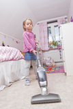 Young Girl with a vacuum cleaner Royalty Free Stock Images