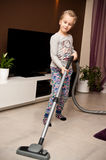Young girl vacuuming room Royalty Free Stock Photos