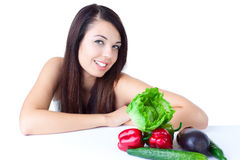 Young girl with  vegetables Royalty Free Stock Images