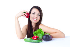 Young girl with  vegetables Stock Photos
