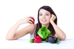Young girl with  vegetables Royalty Free Stock Photos