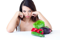 Young girl with  vegetables Stock Photography