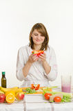Young girl with a vegetarian delight looks at the bell pepper Stock Photo