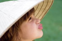 Young girl in the Vietnamese hat Royalty Free Stock Images