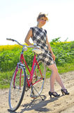 Young girl with a vintage bicycle Stock Photography