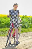 Young girl with a vintage bicycle Royalty Free Stock Photography