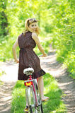 Young girl with a vintage bicycle Royalty Free Stock Photo