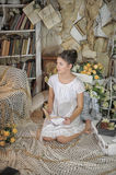 Young girl in a vintage dress. reading a book Royalty Free Stock Images