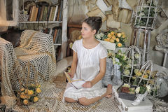 Young girl in a vintage dress. reading a book. Beautiful young girl in a vintage dress Royalty Free Stock Image