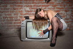 Young girl with vintage TV receiver Royalty Free Stock Image