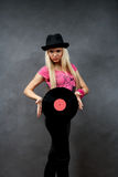 Young girl with a vinyl in a black hat Royalty Free Stock Image