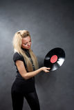Young girl with a vinyl in a black hat Royalty Free Stock Images