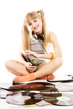 Young girl  with vinyl records. Pretty young girl  with vinyl records over white Royalty Free Stock Photos
