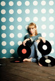 Young girl with vinyl records in the hands Royalty Free Stock Photo