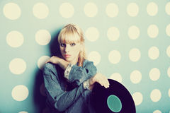 Young girl with vinyl records in the hands Stock Image