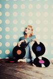 Young girl with vinyl records Royalty Free Stock Images