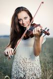 Young girl with violin Royalty Free Stock Photos