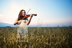 Young girl with violin Royalty Free Stock Images