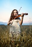 Young girl with violin Stock Images