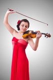 Young girl with violin on white Royalty Free Stock Image