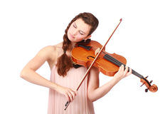 Young girl violinist playing. Beautiful young girl violinist playing over white background Royalty Free Stock Image