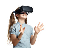 Young girl with virtual reality glasses. Isolated on white background.  VR headset Stock Images