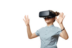 Young girl with virtual reality glasses. Isolated on white background.  VR headset Stock Photos