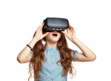 Young girl with virtual reality glasses. Isolated on white background.  VR headset Royalty Free Stock Photo