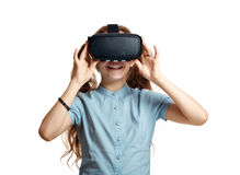 Young girl with virtual reality glasses. Isolated on white background.  VR headset Royalty Free Stock Images
