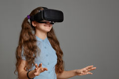 Young girl with virtual reality glasses. VR headset Royalty Free Stock Photos