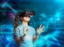 Young girl with virtual reality headset. Young girl using virtual reality glasses. Future technology concept Royalty Free Stock Photo