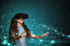 Young girl with virtual reality headset. Young girl using virtual reality glasses. Future technology concept Royalty Free Stock Image