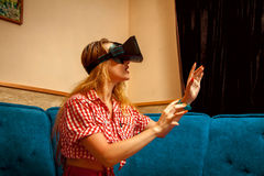 Young girl in virtual reality helmet Stock Photography
