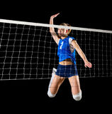 Young girl volleyball player  version with net Royalty Free Stock Images