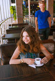 Young girl waiting for a boyfriend in cafe Stock Images