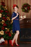Young girl is waiting for Christmas Stock Photography