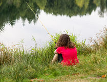 Young girl waiting for fish to bite Royalty Free Stock Photo