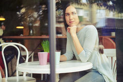 Young girl waiting for someone in the cafe Stock Image