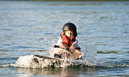 Young Girl Wakeboard/ Pulling Up. A young girl being pulled out of the water. 7 years old stock images